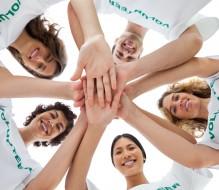 Volunteer group with hands in